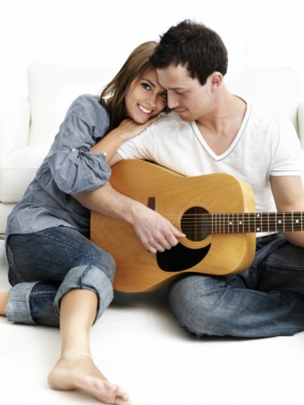 Couple Play Guitar